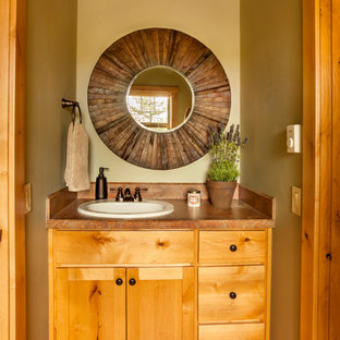Small country master bathroom in Portland with shaker cabinets, brown cabinets, brown tile, mosaic tile, an undermount sink, brown floor, medium hardwood floors, laminate benchtops and brown benchtops.
