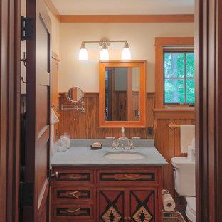 Uriges Badezimmer mit roten Schränken, Wandtoilette mit Spülkasten, weißer Wandfarbe, dunklem Holzboden, Unterbauwaschbecken und Granit-Waschbecken/Waschtisch in Burlington