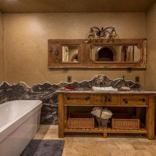 Diseño de cuarto de baño con ducha, rural, pequeño, con lavabo sobreencimera, puertas de armario de madera oscura, bañera exenta, paredes beige, armarios abiertos, baldosas y/o azulejos beige, baldosas y/o azulejos de cerámica, suelo de baldosas de cerámica y encimera de granito