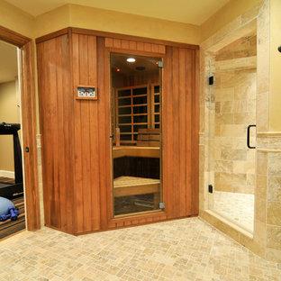 Modelo de sauna clásica renovada con lavabo sobreencimera, armarios tipo mueble, puertas de armario de madera oscura, encimera de granito, sanitario de dos piezas, baldosas y/o azulejos marrones y paredes amarillas