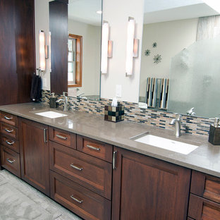 Inspiration for a large rustic master brown tile and porcelain tile porcelain floor bathroom remodel in Seattle with shaker cabinets, dark wood cabinets, a one-piece toilet, beige walls, an undermount sink and quartz countertops