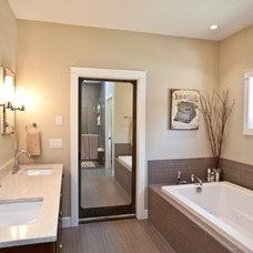 Rustic Bathroom by Penny Lane Home Builders, LLC