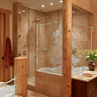 Inspiration for a rustic ensuite bathroom in Seattle with dark wood cabinets, a corner shower, ceramic tiles, ceramic flooring, quartz worktops, freestanding cabinets, brown tiles and a hinged door.