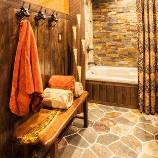 Выдающиеся фото от архитекторов и дизайнеров интерьера: ванная комната среднего размера в стиле рустика с фасадами островного типа, зелеными фасадами, накладной ванной, душем над ванной, раздельным унитазом, оранжевыми стенами, настольной раковиной и столешницей из кварцита