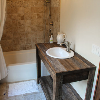 Mid-sized mountain style beige tile ceramic tile bathroom photo in Charlotte with a drop-in sink, open cabinets, wood countertops, beige walls and dark wood cabinets