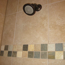 Rustic Bathroom by Red Carpet Construction and Remodeling, Co.