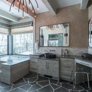 Example of a mountain style master bathroom design in Other with flat-panel cabinets, light wood cabinets, an undermount tub, a vessel sink and brown walls
