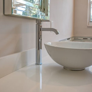 Inspiration for a mid-sized timeless master white tile and stone tile drop-in bathtub remodel in Columbus with a two-piece toilet, pink walls, a vessel sink and solid surface countertops