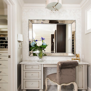 Inspiration for a large transitional master white tile and stone tile marble floor and white floor freestanding bathtub remodel in Other with gray cabinets, gray walls, quartz countertops and beaded inset cabinets