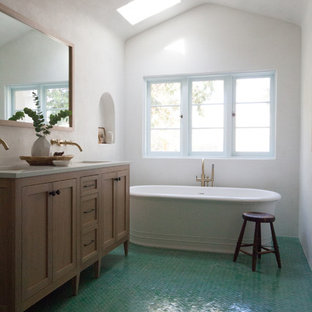 Medium sized mediterranean ensuite bathroom in Los Angeles with recessed-panel cabinets, medium wood cabinets, engineered stone worktops, white worktops, a freestanding bath, white walls, ceramic flooring, a submerged sink and green floors.