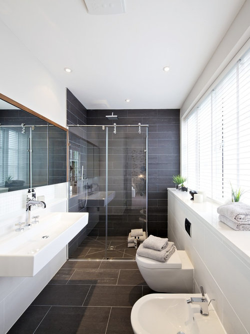 inspiration for a modern bathroom in surrey with a built in shower and grey tiles