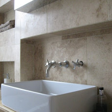 Contemporary Bathroom Safe and Secure with Travertine, brings out a timeless bathroom look