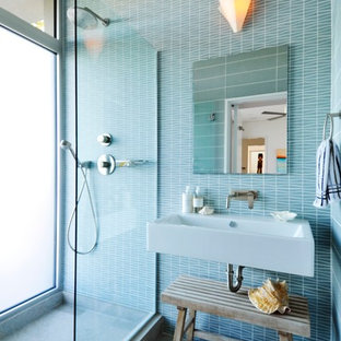 Photo of a large modern bathroom in New York with a wall-mount sink, an open shower, green tile, ceramic tile, green walls and limestone floors.