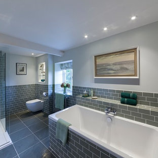 Photo of a medium sized farmhouse ensuite bathroom in Oxfordshire with a walk-in shower, a bidet, white tiles, marble tiles, white walls, porcelain flooring, a console sink, grey floors and an open shower.