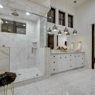 Inspiration for a country master gray tile, white tile and marble tile marble floor and gray floor bathroom remodel in Other with recessed-panel cabinets, white cabinets, white walls, an undermount sink, a hinged shower door and gray countertops