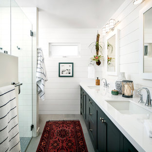 Inspiration for a mid-sized coastal master white tile gray floor walk-in shower remodel in San Francisco with shaker cabinets, blue cabinets, a two-piece toilet, white walls, quartz countertops, a hinged shower door, an undermount sink and white countertops