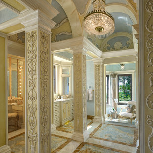Bathroom - huge mediterranean master bathroom idea in Miami with recessed-panel cabinets, yellow cabinets and multicolored walls