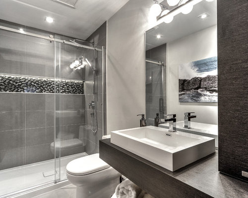 example of a small minimalist bathroom design in montreal with flat panel cabinets dark