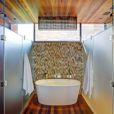 Inspiration for a contemporary brown tile and matchstick tile freestanding bathtub remodel in New York