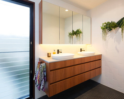 This Is An Example Of A Small Contemporary Master Bathroom In Brisbane With  Medium Wood Cabinets