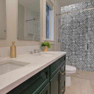 Inspiration for a medium sized classic family bathroom in Seattle with shaker cabinets, green cabinets, an alcove shower, a one-piece toilet, white tiles, porcelain tiles, grey walls, porcelain flooring, a submerged sink, engineered stone worktops, brown floors, a sliding door and white worktops.