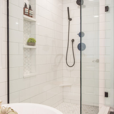 Bathroom - mid-sized country master white tile and subway tile porcelain tile and black floor bathroom idea in Seattle with shaker cabinets, light wood cabinets, a one-piece toilet, white walls, an undermount sink, a hinged shower door, white countertops and quartz countertops