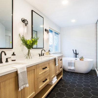 Example of a mid-sized farmhouse master white tile and subway tile porcelain tile, black floor and double-sink bathroom design in Seattle with shaker cabinets, white walls, an undermount sink, a hinged shower door, white countertops, quartz countertops, medium tone wood cabinets, a niche and a built-in vanity