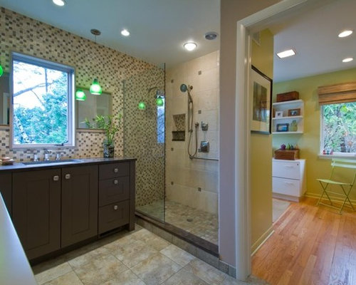 contemporary bathroom idea in detroit with an undermount sink shaker cabinets dark wood cabinets