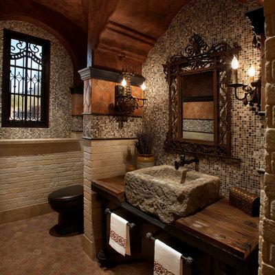 Bathroom - mediterranean mosaic tile bathroom idea in Phoenix with wood countertops, a vessel sink and brown countertops