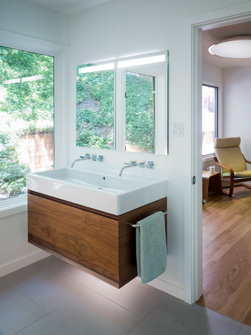 midsized trendy master bathroom photo in san francisco with porcelain tile a trough