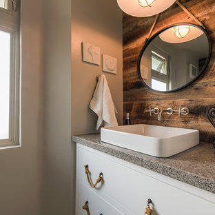 Inspiration for a mid-sized beach style 3/4 bathroom remodel in San Diego with a vessel sink, flat-panel cabinets, white cabinets, beige walls, engineered quartz countertops and gray countertops