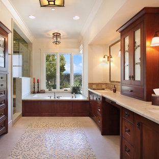 Aménagement d'une grand douche en alcôve principale craftsman avec un lavabo encastré, un placard avec porte à panneau encastré, des portes de placard en bois sombre, un carrelage beige, carrelage en mosaïque, un mur beige, un sol en carrelage de céramique, une baignoire encastrée, un plan de toilette en quartz, un sol beige et une cabine de douche à porte battante.