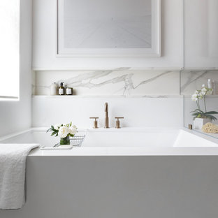 Example of a large trendy master gray tile and subway tile marble floor and white floor corner shower design in San Francisco with an undermount tub, white walls, flat-panel cabinets, light wood cabinets, an undermount sink, engineered quartz countertops and a hinged shower door