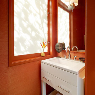 Inspiration for an eclectic bathroom remodel in San Francisco with an undermount sink, flat-panel cabinets, white cabinets and orange walls