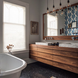 Inspiration for a contemporary mosaic tile floor and black floor claw-foot bathtub remodel in San Francisco