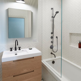 Inspiration for a small 1950s master white tile and ceramic tile cement tile floor, white floor and single-sink bathroom remodel in San Francisco with an undermount tub, a two-piece toilet, flat-panel cabinets, light wood cabinets, white walls, an integrated sink, white countertops, a niche and a floating vanity