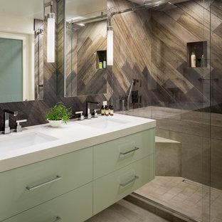 Inspiration pour une salle d'eau design en bois avec un placard à porte vitrée, des portes de placard blanches, une douche ouverte, un carrelage marron, un carrelage imitation parquet, un mur marron, un lavabo intégré, un plan de toilette en surface solide, une cabine de douche à porte coulissante, un plan de toilette blanc, une niche, un banc de douche, meuble double vasque, meuble-lavabo suspendu et du lambris.