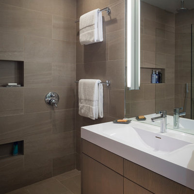 Doorless shower - mid-sized modern master brown tile and porcelain tile porcelain tile doorless shower idea in San Francisco with an integrated sink, flat-panel cabinets, medium tone wood cabinets, quartz countertops and white walls
