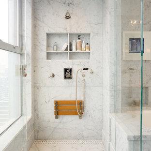 На фото: главная ванная комната среднего размера в стиле современная классика с полновстраиваемой ванной, угловым душем, серыми стенами, врезной раковиной, мраморной столешницей, душем с распашными дверями, нишей и сиденьем для душа