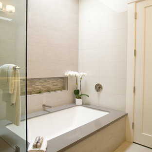 Small transitional gray tile porcelain floor bathroom photo in Omaha with an undermount tub and green walls