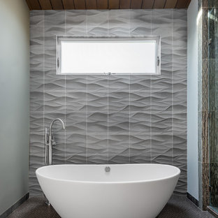 This is an example of a small contemporary bathroom in San Francisco with a freestanding bath, grey walls, grey tiles and mosaic tile flooring.