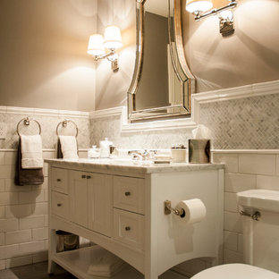 Inspiration for a mid-sized transitional 3/4 white tile and subway tile porcelain floor and gray floor bathroom remodel in Orange County with an undermount sink, shaker cabinets, white cabinets, marble countertops, a two-piece toilet, a hinged shower door, gray walls and white countertops
