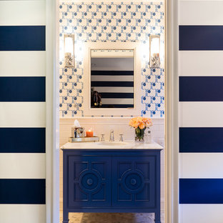 Mid-sized eclectic 3/4 bathroom in San Francisco with furniture-like cabinets, blue cabinets, white tile, ceramic tile, blue walls, marble floors, an undermount sink, marble benchtops and grey floor.