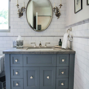 Elegant bathroom photo in Santa Barbara with an undermount sink, blue cabinets and gray countertops