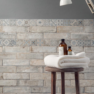 Bathroom - eclectic multicolored tile and porcelain tile bathroom idea in San Francisco with gray walls