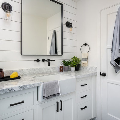 Inspiration for a small cottage 3/4 white tile and porcelain tile porcelain tile and gray floor bathroom remodel in Los Angeles with shaker cabinets, white cabinets, a one-piece toilet, white walls, a trough sink, marble countertops and gray countertops