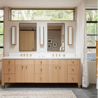 Bathroom - scandinavian master bathroom idea in Los Angeles with flat-panel cabinets, light wood cabinets and marble countertops