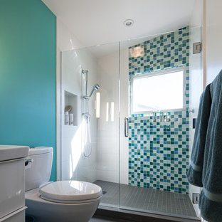 This is an example of a mid-sized midcentury kids bathroom in Los Angeles with green tile, green walls, an undermount sink, flat-panel cabinets, white cabinets, an alcove shower and glass tile.