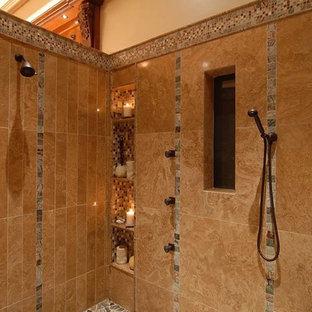 Esempio di una grande stanza da bagno padronale mediterranea con consolle stile comò, ante in legno scuro, vasca freestanding, doccia ad angolo, bidè, piastrelle beige, piastrelle a mosaico, pareti beige, pavimento con piastrelle in ceramica, lavabo da incasso, top in granito, pavimento beige e doccia aperta