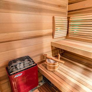 Idee per una grande sauna stile rurale con ante in stile shaker, ante in legno chiaro, vasca freestanding, doccia aperta, WC monopezzo, piastrelle grigie, piastrelle di cemento, pareti grigie, pavimento in cementine, lavabo sottopiano, top in granito, pavimento grigio e porta doccia scorrevole
